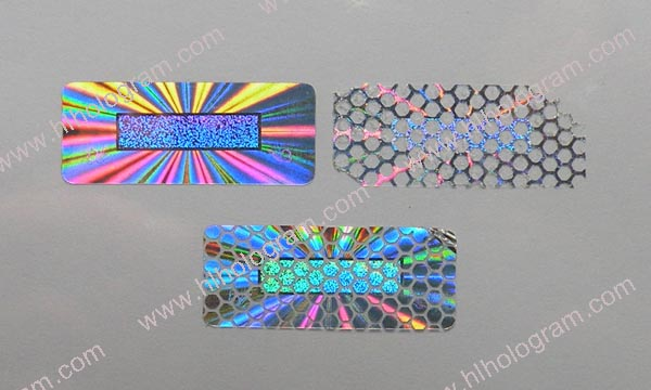 Pressure tamper evident pattern released with Honeycomb hologram sticker.  This holographic label leaves beehive shape residue on paper after sticker  peeled ...